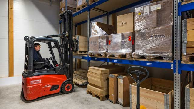 Photograph: Moving stock in the warehouse at SI Technik Headquarters